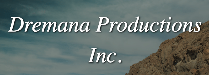 "The test ""Dremana Productions Inc."" in front of a cloud-filled blue sky and a cliff."